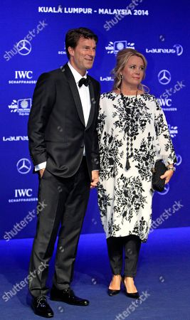 Michael Laudrup, Siw Laudrup Former Danish soccer player Michael Laudrup, left, and his wife Siw Laudrup pose for photos upon arriving at the Laureus World Sports Awards in Kuala Lumpur, Malaysia