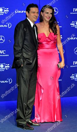 Jari Litmanen, Ly Jurgenson Former Finnish soccer player Jari Litmanen, left, and his wife Ly Jurgenson pose for photos upon arriving at the Laureus World Sports Awards in Kuala Lumpur, Malaysia