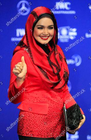 Stock Image of Siti Nurhaliza Malaysian singer Siti Nurhaliza poses for photos upon arriving at the Laureus World Sports Awards in Kuala Lumpur, Malaysia