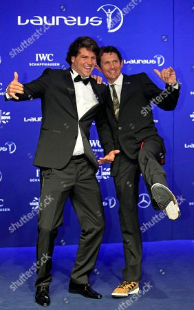 Stock Picture of Michael Teuber, Philip Koster Laureus Ambassador Michael Teuber, right, and Germany's windsurfer Philip Koster pose for photos upon arriving at the Laureus World Sports Awards in Kuala Lumpur, Malaysia