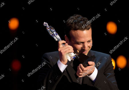 """Amat Escalante Director Amat Escalante celebrates after winning the Ariel for best director for his film, """"Heli,"""" in the Palace of Fine Arts in Mexico City, . The Mexican Academy of Cinematographic Arts and Sciences held its annual Ariel Awards ceremony on Tuesday night"""