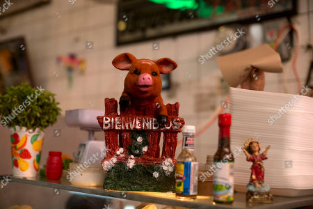 """A ceramic pig adorns the """"La Tia"""" stall, which sells tacos and sandwiches of cochinita pibil, the famous shredded pork slow-roasted in orange juice, at the Central Market in Merida, Mexico. American celebrity chef Jeremiah Tower said that he visits the city's central covered market in the mornings and spends his afternoons working on a new book, an illustrated dictionary of the historical intersection of food and sex"""