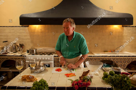 """Jeremiah Tower American chef Jeremiah Tower prepares the kitchen at his home after shopping at local markets in Merida, Mexico. Tower said he sees his book, working title """"Sexual Eating,"""" as a remedy to the over-serious treatment of food by modern American chefs, critics and consumers, the unfortunate extension of a trend that he helped create"""