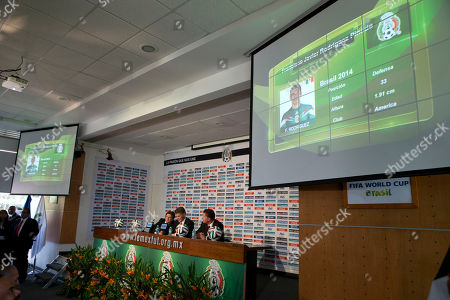 Miguel Herrera, Hector Gonzalez, Ricardo Pelaez Mexican soccer team head coach Miguel Herrera, center left, Director of National Selection Hector Gonzalez, center, and athletic director Ricardo Pelaez talk during a video showcasing the players selected for Mexico's 2014 Brazil World Cup team, at a press conference in Mexico City