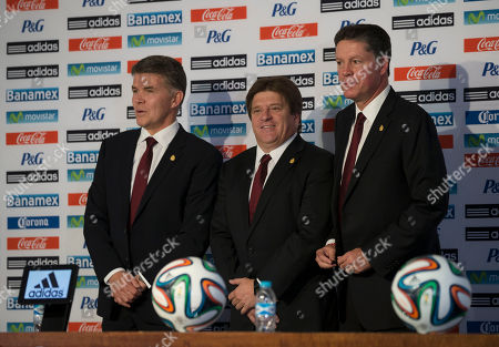 Hector Gonzalez, Miguel Herrera, Ricardo Pelaez Mexican soccer team head coach Miguel Herrera, center, poses for a picture with Director of National Selection Hector Gonzalez, left, and athletic director Ricardo Pelaez, at a press conference to announce the World Cup lineup, in Mexico City