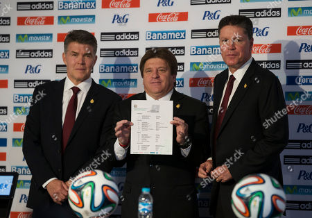 Hector Gonzalez, Miguel Herrera, Ricardo Pelaez Mexican soccer team head coach Miguel Herrera, center, holds up the list of players selected for Mexico's 2014 Brazil World Cup team, as he poses for a picture with Director of National Selection Hector Gonzalez, left, athletic director Ricardo Pelaez, at a press conference to announce the World Cup lineup, in Mexico City