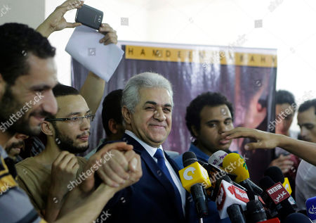 Hamdeen Sabahi Presidential hopeful Hamdeen Sabahi, center, is greeted by his supporters during a press conference at his campaign headquarters in Cairo, Egypt, . The defeated candidate in Egypt's presidential candidate has accepted defeat by the nation's former military chief, retired field marshal Abdel-Fattah el-Sissi, but said turnout figures announced by the government are not credible. With nearly all ballots counted, Egypt's former military chief has won a crushing victory over his sole opponent Sabahi in the country's presidential election, his campaign said Thursday. But the results were stained by questions about turnout despite a robust government effort to get out the vote