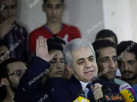 Hamdeen Sabahi Presidential hopeful Hamdeen Sabahi talks as he is surrounded by his campaign members during a press conference at his campaign headquarters in Cairo, Egypt, . The defeated candidate in Egypt's presidential candidate has accepted defeat by the nation's former military chief, retired field marshal Abdel-Fattah el-Sissi, but said turnout figures announced by the government are not credible. With nearly all ballots counted, Egypt's former military chief has won a crushing victory over his sole opponent Sabahi in the country's presidential election, his campaign said Thursday. But the results were stained by questions about turnout despite a robust government effort to get out the vote