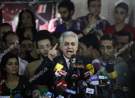Presidential hopeful Hamdeen Sabahi talks as he is surrounded by his campaign members during a press conference at his campaign headquarters in Cairo, Egypt, . The defeated candidate in Egypt's presidential candidate has accepted defeat by the nation's former military chief, but said turnout figures announced by the government are not credible. With nearly all ballots counted, Egypt's former military chief, retired field marshal Abdel-Fattah el-Sissi, has won a crushing victory over his sole opponent Sabahi in the country's presidential election, his campaign said Thursday. But the results were stained by questions about turnout despite a robust government effort to get out the vote