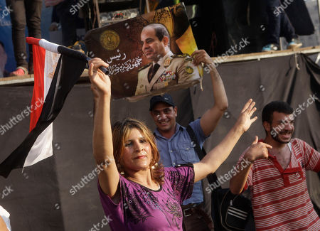 Supporters of Egypt's president-elect Abdel-Fattah el-Sissi dance as they celebrate Tuesday's official announcement declaring him the next president at Tahrir Square in Cairo, Egypt, . Interim President Adly Mansour will hand over office to former army chief el-Sissi, who oversaw Islamist President Mohammed Morsi's removal and who won last week's presidential elections in a landslide. El-Sissi is to be sworn in on Sunday