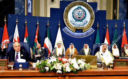 Emir of Kuwait, Sheikh Sabah al-Ahmad al-Sabah, right, and Secretary-General of the League of Arab States, Nabil El Araby, left, attend the closing session of the Arab League Summit at Bayan Palace, Kuwait