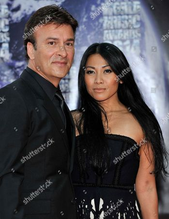 Indonesian and French-naturalised singer-songwriter Anggun and Portuguese musician Tony Carreira pose as they arrive for the World Music Awards in Monaco, . The awards are presented to the world's best-selling artists in various categories and to the best-selling artists from each major territory