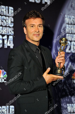 Portuguese musician Tony Carreira poses after he received the Best Selling Portuguese artist award during the World Music Awards ceremony in Monaco, . Awards are presented to the world's best-selling artists in the various categories and to the best-selling artists from each major territory