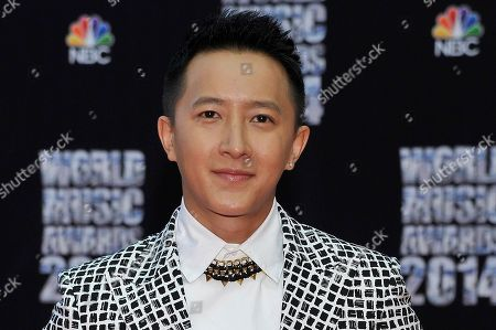 Chinese singer Han Geng poses as he arrives for the World Music Awards in Monaco, . The awards are presented to the world's best-selling artists in various categories and to the best-selling artists from each major territory