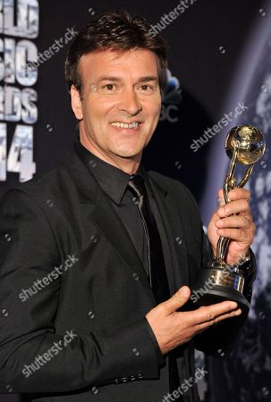 Portuguese musician Tony Carreira poses after he received an award during the World Music Awards ceremony in Monaco, . Awards are presented to the world's best-selling artists in the various categories and to the best-selling artists from each major territory