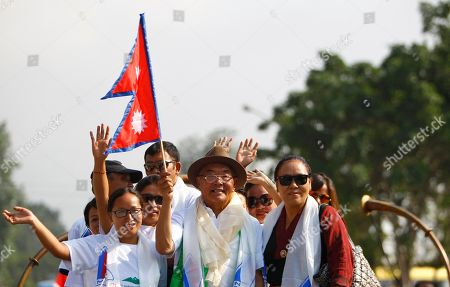 Kancha Sherpa 81-year-old Kancha Sherpa, the lone surviving member of the first expedition to reach the top of Mount Everest, holds a Nepalese flag and participates with mountaineers and trekking guides in a rally to mark the 61st anniversary of the conquest of Mount Everest in Katmandu, Nepal, . New Zealander Edmund Hillary and his Sherpa guide, Tenzing Norgay, became the first climbers to reach the top of Everest on May 29, 1953. More than 4,200 climbers have scaled the 8,850-foot (29,035-foot) summit since then