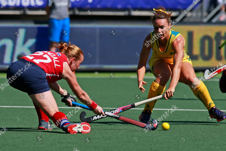 Captain Lauren Crandall of the U.S., left, and Australia's Georgie Parker, right, fight for the ball during the Field Hockey World Cup semifinal match women between the U.S. and Australia in The Hague, Netherlands
