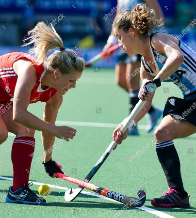 Argentina's captain Rosario Luchetti, right, tries to pass England's Georgie Twigg, during their Field Hockey World Cup match in The Hague, Netherlands, . England did not progress to the next round