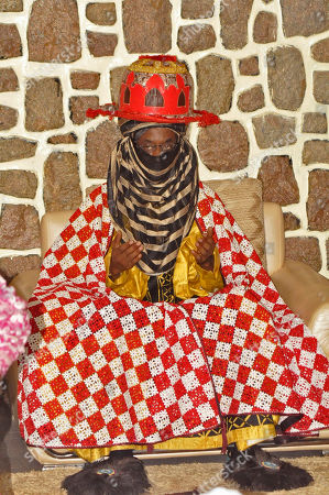Traditional ruler Lamido Sanusi takes part in a prayer meeting, at Kano State Government house in Kano, Nigeria. Lamido Sanusi was appointed on Sunday, June 8, 2014, as the new emir of Kano, replacing Emir Ado Bayero who died at age 83