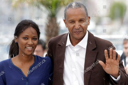 """Abderrahmane Sissako, Toulou Kiki Director Abderrahmane Sissako, right, and actress Toulou Kiki during a photo call for """"Timbuktu"""" at the 67th international film festival, Cannes, southern France. The film is nominated for an Oscar for best foreign language film. The 87th Annual Academy Awards are held, at the Dolby Theatre in Los Angeles"""