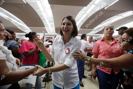 Marta Linares Marta Linares, the wife of Panama's President Ricardo Martinelli, vice president candidate for the Democratic Change Party, greets women as she campaigns in Panama City. Barred by the constitution from seeking immediate re-election, President Martinelli is counting on his wife and another loyalist newcomer, presidential candidate Jose Domingo Arias, to protect his legacy for transforming Panama into one of the world's fastest-growing economies. Panama will hold general election on May 4