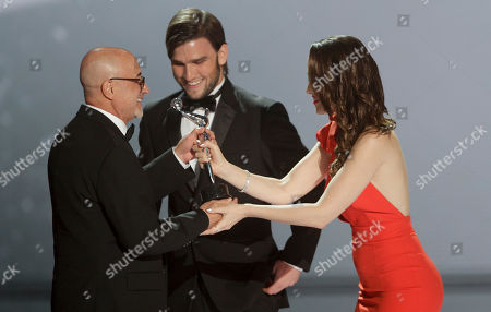 Emilio Kauderer, Natalia Oreiro, Lucas Vidal Argentina's musician Emilio Kauderer receives the best musical score award from Uruguay's actress Natalia Oreiro and Spain's actor Lucas Vidal, center, during the first edition of the Platino Ibero-American Cinema Awards at the Anayansi theater in Panama City