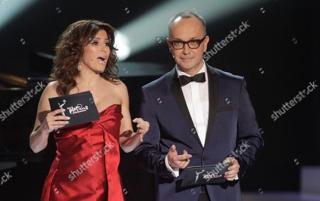 Juan Carlos Arciniegas, Alessandra Rosaldo Colombia's entertainment journalist Juan Carlos Arciniega, right, and Mexican singer and actress Alessandra Rosaldo host the first edition of the Platino Ibero-American Cinema Awards at the Anayansi theater in Panama City