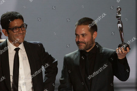 "Sebastian Lelio, Gonzalo Maza Director Sebastian Lelio from Chile, raises his award for Best fiction movie for his film ""Gloria"" as screenwriter Gonzalo Maza stands next to him during the first edition of the Platino Ibero-American Cinema Awards at the Anayansi theater in Panama City"