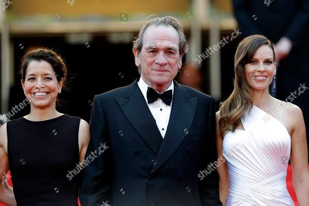 """From left, Dawn Laurel-Jones, director Tommy Lee Jones, and actress Hillary Swank pose for photographers as they arrive for the screening of """"The Homesman,"""" at the 67th international film festival, in Cannes, southern France. The Academy award winner Jones wears more than one cowboy hat in his new Western, giving him full control of everything. The film stars himself and fellow Academy award winner Swank. The movie opens in U.S. theatres this"""