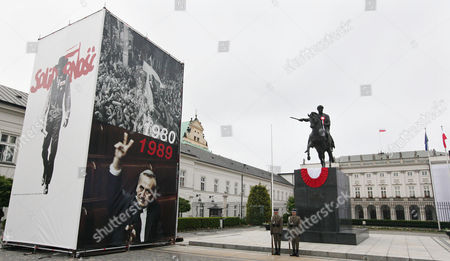 Pictures of Lech Walesa leading the 1980 strike that gave rise to the Solidarity freedom movement, top and of prime minister Tadeusz Mazowiecki flashing a v-sign in 1989, bottom, are on display in front of the Presidential Palace in Warsaw, Poland, on the eve of the visit of US President Barack Obama and other European leaders who will attend celebrations marking 25 years of Poland's democracy