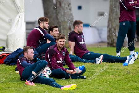 Wayne Rooney, Steven Gerrard England's Wayne Rooney, left, and captain Steven Gerrard, center, takea break during a training session in Vale do Lobo, near Almancil, southern Portugal, . England will play the World Cup in Brazil in Group D with Uruguay, Costa Rica and Italy
