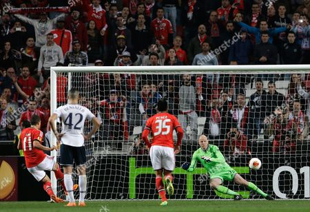 Lima, Brad Friedel Benfica's Lima, left, scores their second goal from the penalty spot past Tottenham Hotspur's goalkeeper Brad Friedel, right, during their Europa League round of 16, second leg, soccer match, at Benfica's Luz stadium
