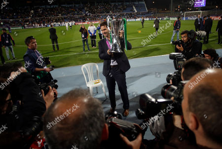 Wolfsburg's coach Ralf Kellermann poses for the media with the trophy after his team win the Women's Champions League at the Restelo stadium in Lisbon, . Wolfsburg defeated Tyreso 4-3 in the final match