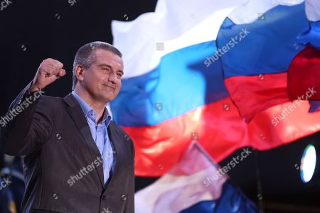 Sergey Aksyonov Crimea's Russian-backed leader Sergey Aksyonov gestures as people celebrate in Lenin Square, in downtown Simferopol, Ukraine. The United States and its European allies stepped up their pressure on Russia to end its intervention in Ukraine by imposing the most comprehensive sanctions against Russian officials since the Cold War. Sergey Aksyonov is one of four Ukrainians newly targeted by the Treasury Department for his status as prime minister of Crimea's regional government