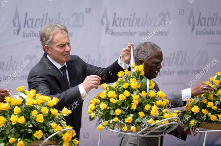 Tony Blair, Thabo Mbeki Former British Prime Minister Tony Blair, left, and Former South African President Thabo Mbeki, right, lay a memorial wreath at a ceremony to mark the 20th anniversary of the Rwandan genocide, held at the Kigali Genocide Memorial Center in Kigali, Rwanda