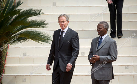 Tony Blair, Thabo Mbeki Former British Prime Minister Tony Blair, left, and Former South African President Thabo Mbeki, right, arrive to lay a memorial wreath at a ceremony to mark the 20th anniversary of the Rwandan genocide, held at the Kigali Genocide Memorial Center in Kigali, Rwanda . Sorrowful wails and uncontrollable sobs resounded Monday as thousands of Rwandans packed the country's main sports stadium to mark the 20th anniversary of the beginning of a devastating 100-day genocide