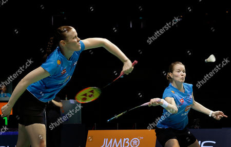 Kamilla Rytter Juhl, Christinna Pedersen Kamilla Rytter Juhl, left, and Christinna Pedersen of Denmark return a shot to Bao Yixin and Tang Jinhua of China during their women's doubles final match at the Singapore Open Badminton championship on in Singapore