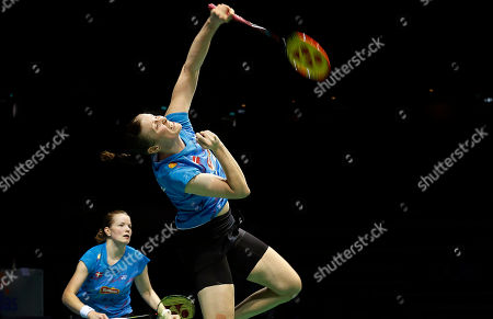 Stock Photo of Kamilla Rytter Juhl, Christinna Pedersen Kamilla Rytter Juhl, right, and Christinna Pedersen, left, of Denmark return a shot to Bao Yixin and Tang Jinhua of China during their women's doubles final match at the Singapore Open Badminton championship on in Singapore
