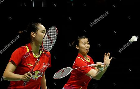 Stock Picture of Bao Yixin, Tang Jinhua Bao Yixin, left, and Tang Jinhua of China return a shot to Kamilla Rytter Juhl and Christinna Pedersen of Denmark during their women's doubles final match at the Singapore Open Badminton championship on in Singapore