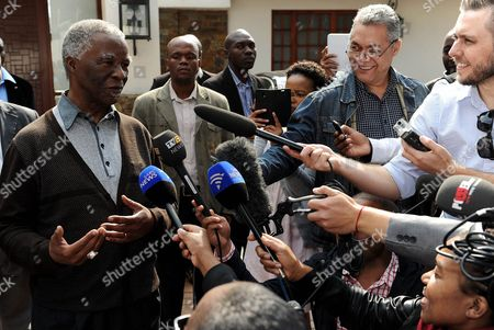 Thabo Mbeki Former South African President Thabo Mbeki, left, talks to the media at his home after casting his special early vote, ahead of polls opening to the general public on Wednesday for the fifth democratic elections, in Johannesburg, South Africa