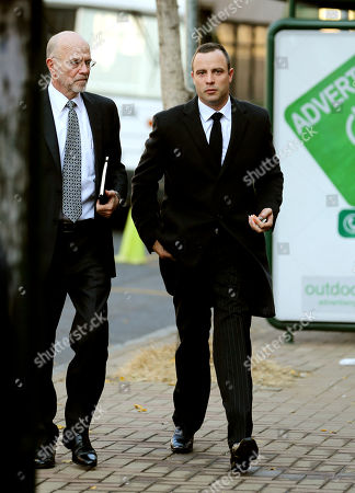 Oscar Pistorius Oscar Pistorius, right, accompanied by his uncle Arnold Pistorius arrives at the high court in Pretoria, South Africa, . Pistorius is charged with murder for the shooting death of his girlfriend Reeva Steenkamp on Valentine's Day in 2013