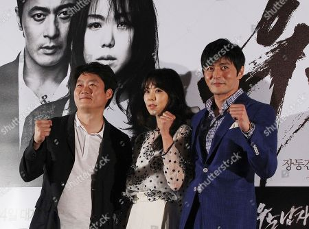 """Kim Min-hee, Jang Dong-gun, Lee Jung-beom South Korean actress Kim Min-hee, actor Jang Dong-gun and director Lee Jung-beom, left, pose for photographers during a press conference to promote their latest movie """"No Tears for the Dead"""" in Seoul, South Korea"""