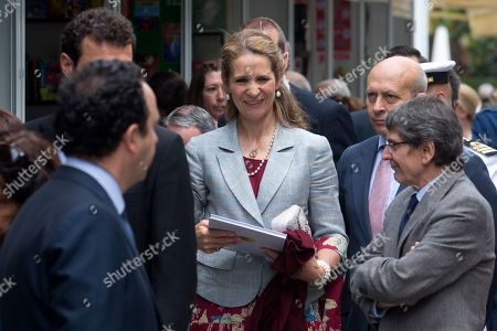 Princess Elena, Jose Ignacio Wert Spain's Princess Elena, centre, accompanied by Culture Minister Jose Ignacio Wert, 2nd right, holds a book while visiting some of the stands at the opening of the 73rd book fair in Madrid, Spain, . The book fair with 451 exhibitors runs through to June 15