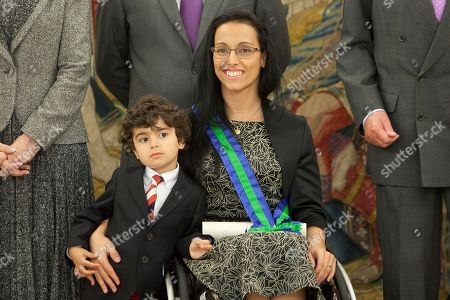 Mariano Menor, Maria Teresa Perales Spanish Paralympic swimmer Maria Teresa Perales, centre, and her son Mariano Menor, left, pose for photographers after the imposed the Grand Cross of the Royal Order of Sporting Merit at Zarzuela Palace in Madrid, Spain on