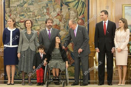 Princess Elena of Spain, Queen Sofia of Spain, Mariano Menor, Mariano Menor, Maria Teresa Perales, King Juan Carlos of Spain, Prince felipe of Spain, Princess Letizia of Spain L-R) Princess Elena of Spain, Queen Sofia of Spain, Mariano Menor and his son Mariano Menor, Spanish paralympic swimmer Maria Teresa Perales, King Juan Carlos of Spain, Prince felipe of Spain, Princess Letizia of Spain, in the centre of the pic, King Juan Carlos of Spain speaks with Spanish paralympic swimmer Maria Teresa Perales before the imposed the Grand Cross of the Royal Order of Sporting Merit at Zarzuela Palace in Madrid, Spain on
