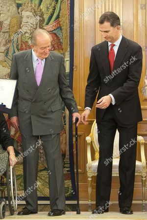King Juan Carlos of Spain, Prince Felipe of Spain King Juan Carlos of Spain gives his crutch to Prince Felipe of Spain during the imposition of the Grand Cross of the Royal Order of Sporting Merit to the Spanish Paralympic swimmer Maria Teresa Perales at Zarzuela Palace in Madrid, Spain on