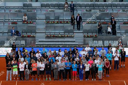 """Andy Murray, Elena Baltacha, Manuel Santana Andy Murray, first row, center, and """"Manolo"""" Santana, first row center left, stand together with players and ATP staff after a minute of silence for Elena Baltacha before a Madrid Open tennis tournament match between Yvonne Meusburger from Austria and Carla Suarez Navarro from Spain in Madrid, Spain, . Former top-50 British women's player Elena Baltacha died of liver cancer at the age of 30 early on Sunday morning, her family have announced"""
