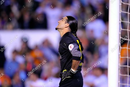 Barcelona goalkeeper Jose Manuel Pinto reacts after Real's Angel Di Maria scored the opening goal during the final of the Copa del Rey between FC Barcelona and Real Madrid at the Mestalla stadium in Valencia, Spain