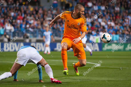 Sergio Sanchez, Karim Benzema Real Madrid's Karim Benzema, right, in action with CF Malaga's Sergio Sanchez, left, during a Spanish La Liga soccer match at La Rosaleda stadium in Malaga, Spain