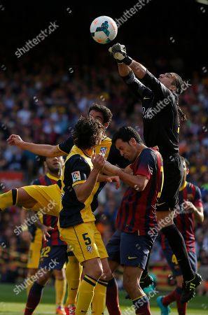 Jose Manuel Pinto Barcelona goalkeeper Jose Manuel Pinto, right punches the ball away during a Spanish La Liga soccer match between FC Barcelona and Atletico Madrid at the Camp Nou stadium in Barcelona, Spain
